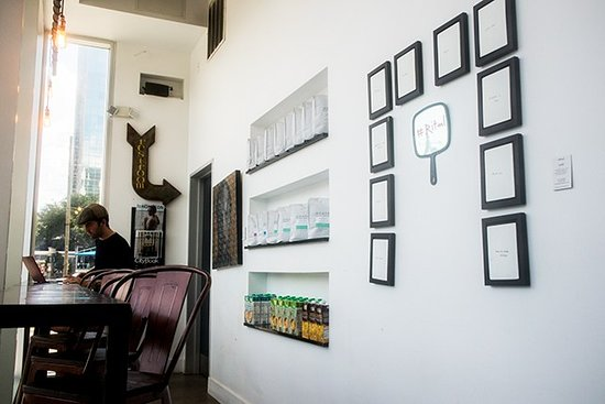Cavo Coffee: Corner with coffee beans on sale as well as artwork by a local artist.