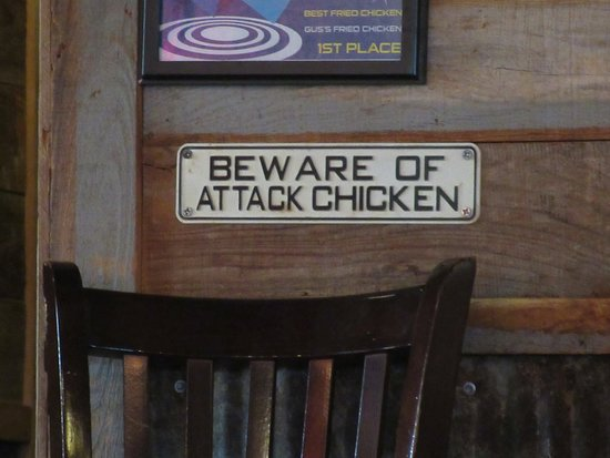 Gus's World Famous Fried Chicken: Funny signs are part of the decor