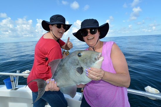 Distraction Charters: mom and daughter catching triggerfish and having fun