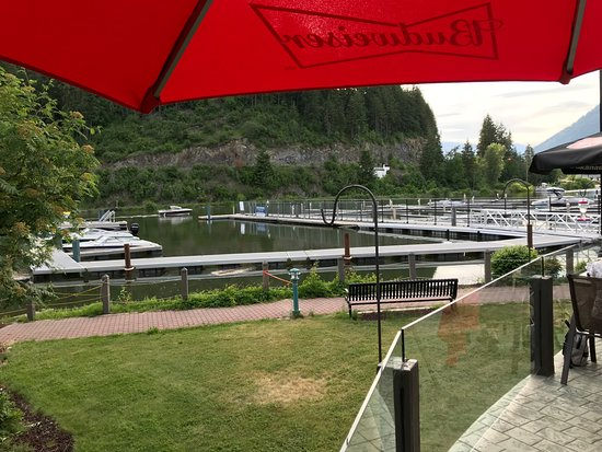 """Moose Mulligans: Outdoor patio - """"non-smoking section"""" is under the roof jut-out near the umbrella"""