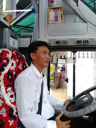 JJ Express: bus driver with the family photo above