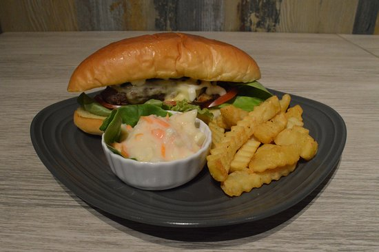 Lucaffe: Beef-burger with cheese and fresh salad in a long bun, served with fries and coleslaw