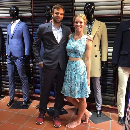 Blue Eye Tailor: clients happy with the fitting result.)