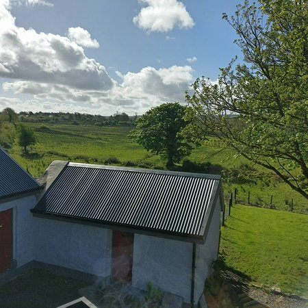 Dromahair, Ireland: Partial view, big expansive view of fields from our window