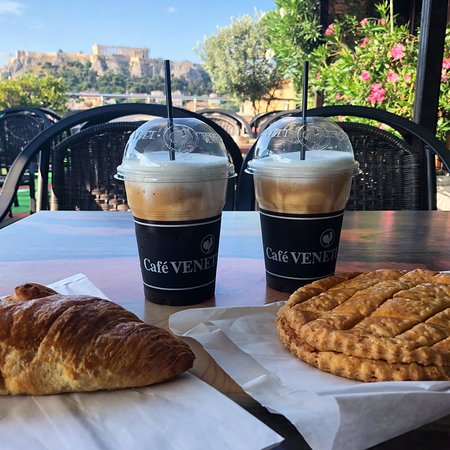 Attalos Hotel: Having pastries and freddo cappuccinos from a nearby bakery on the rooftop patio.