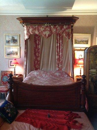 Scotney Castle Garden: The Red Bedroom inside the mansion
