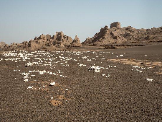 Shahdad, Iran: White rocks on brown sand