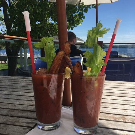 Wolfeboro, NH: Delicious and spicy Bloody Mary with thick slices of bacon!
