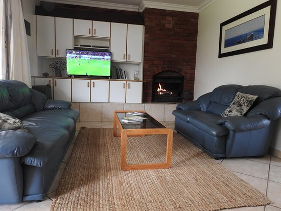 Waterford Guest House: Guinea Fowl lounge, sunny and spacious with open log fireplace, perfect for winter.