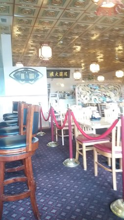 King WHA Restaurant : Bar seating is roped off from the main dining room.