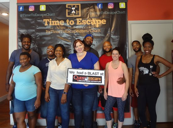 Time to Escape: the Escape Room Experience (Chattanooga): The smiles never left this fun group's face! They were one step away from victory.