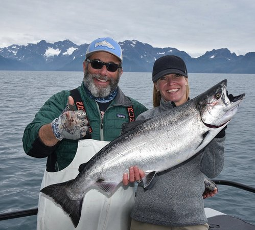 Gray Light Seward Alaska: Typical King Salmon and typical stoked fisherwomen and Captain Andy