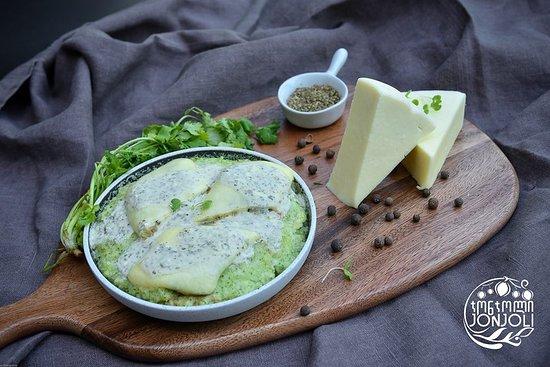 Jonjoli: Minted Cheese Balls with Green Grits and   Yogurt Sauc