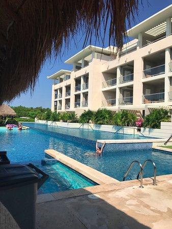 Paradisus Playa del Carmen La Perla: view from pool bar and looking at swim up suites
