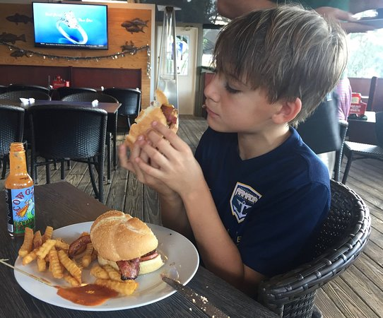 LuLu's Waterfront Grille : Tommy and his burger at Lulu's