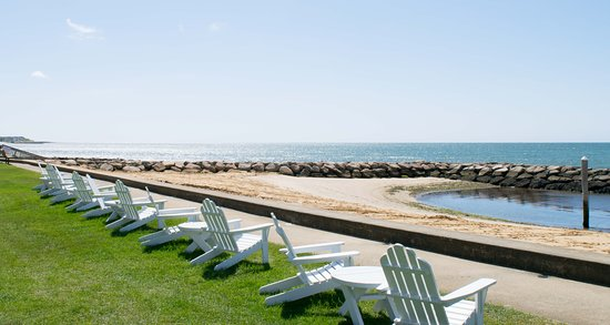 The Waterfront: Enjoy a cocktail steps from the ocean in one of our adirondack chairs