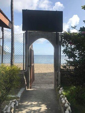Hummingbird Beach Resort : Door to beach from hotel grounds.