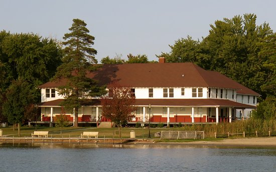 Cedar Lake, IN: Enjoy summer sunsets from our wraparound porch.