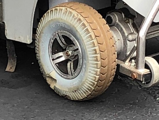 Gurnee, IL: Wheel on scooter for disabled person