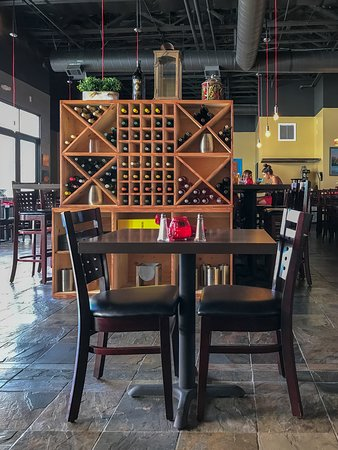 The Parkway American Grill: Seating area including wine rack