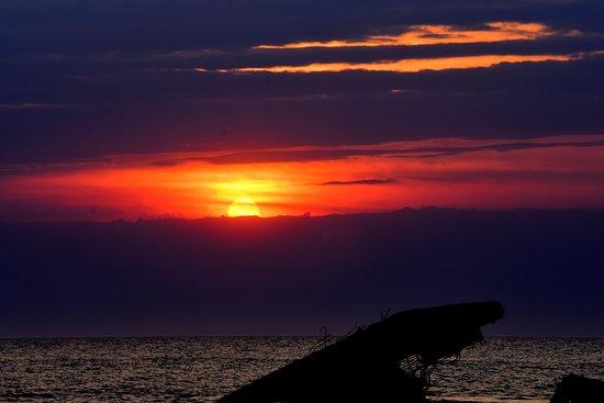 Sunset Beach : couple on rocks at sunset