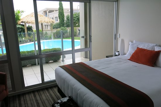 The Reef Resort - Heritage Collection: Poolside room and Pool outside