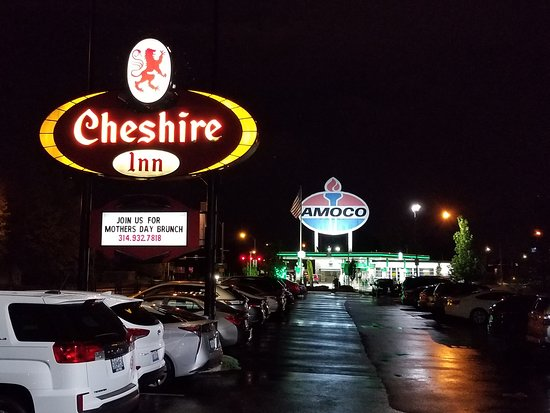 The Cheshire: The original big sign with the giant landmark Amoco sign in the background.