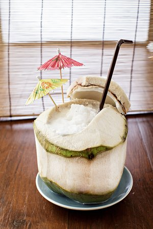 Cafe de ThaanAoan : Our fresh coconut juice serve fresh from the coconut.