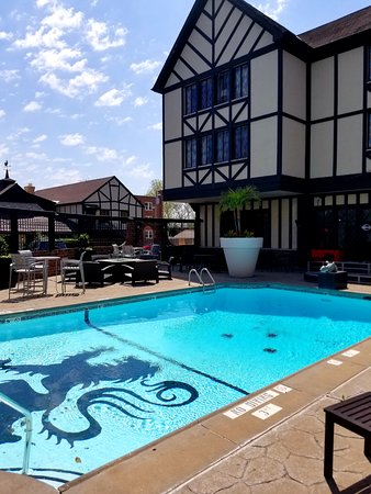 The Cheshire : Photo of the pool shows the hotel's Tudor-style exterior.