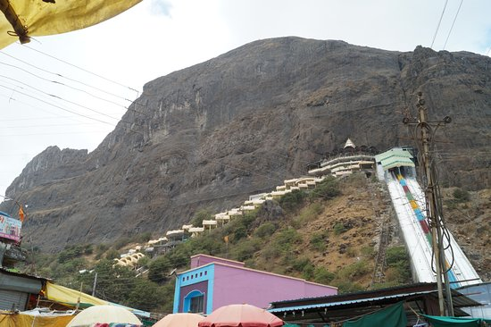 The Saptashrungi temple hill; left the steps, right the direct reach facility