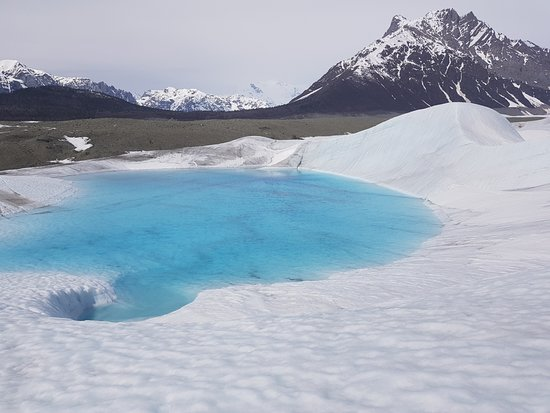 Kennicott Wilderness Guides: Big blue pool and wavy hill on Root Glacier