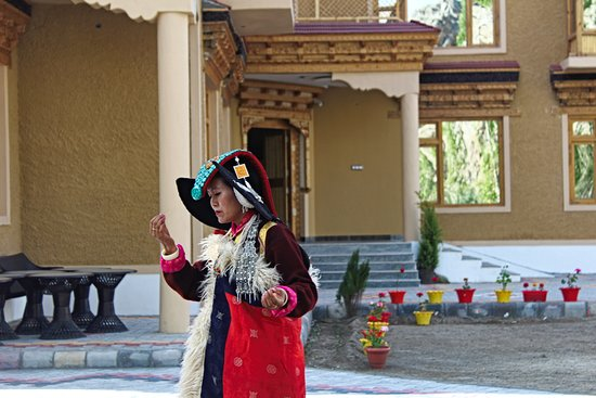 Ladakhi Lady performing in cultural attire at Hotel Togochey