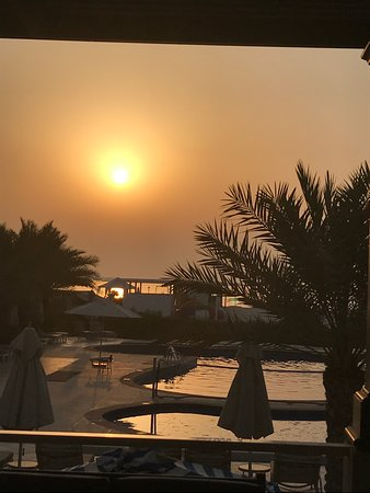 Al Hamra Residence & Village: view from marjan bar towards childrens pool and beach at sunset