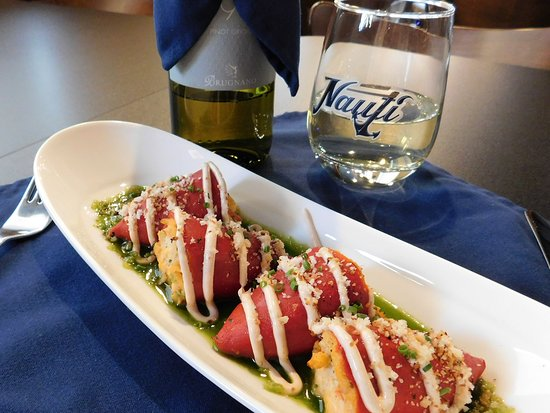 The Nauti Inn Barstro: Homemade filling, sauces and toppings: Lump Crab Stuffed Piquillo Peppers on Chive Oil with Chip