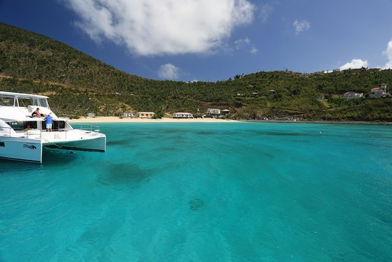 Dream Yacht Charter : A catamaran in the BVIs beautiful blue water.