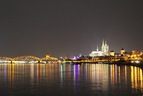 Hohenzollern Bridge: The bridge lit up at night