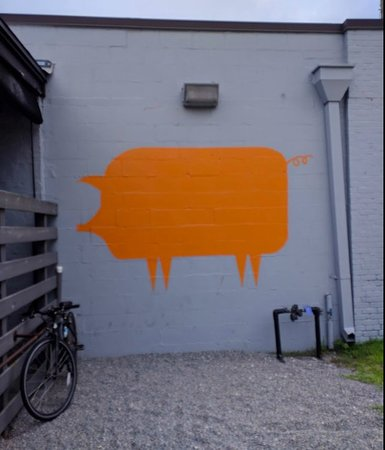 The Bearded Pig BBQ : This pig is painted on the wall on as you go into the patio area