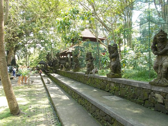 Sacred Monkey Forest Sanctuary: The row of sculptures outside one of the small temples in the Forest