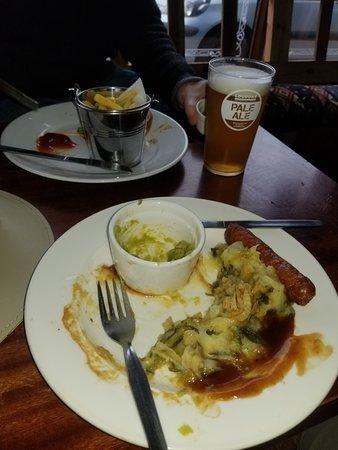 Scarriff, Ireland: My half eaten plate of Bangers, Colcannon potatoes and mushy peas,