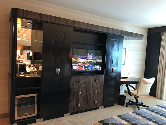 MotorCity Casino Hotel: Mini bar and entertainment station with work desk / power station
