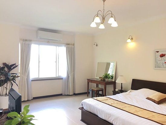 Lakeview Villas, Vietnam Golf & Country Club: the master bedroom of villa with lake view