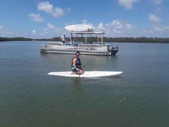 Paddle Out Adventures: She was nervous about standind so Captain Andrew suggested she kneel at first.