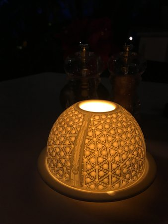 Julians - A Tropical French Bistro : Beautiful design details like this votive holder