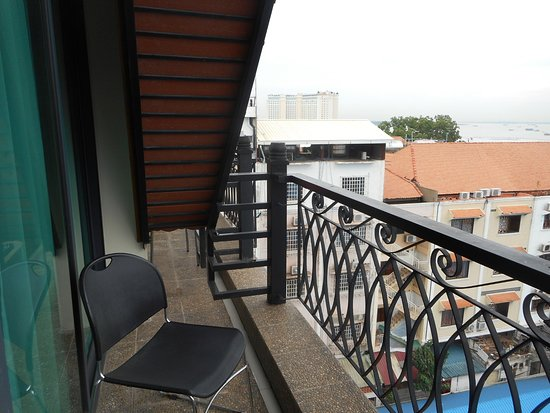 "Ohana Phnom Penh Palace Hotel: The small south side balcony and ""comfy"" chair"
