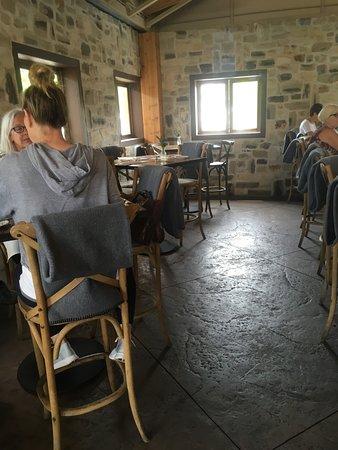 Farmhouse at Roger's Gardens: Bar area seating