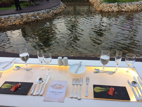 Moon Palace Cancun: Romantic Dinner - Table setting around lake