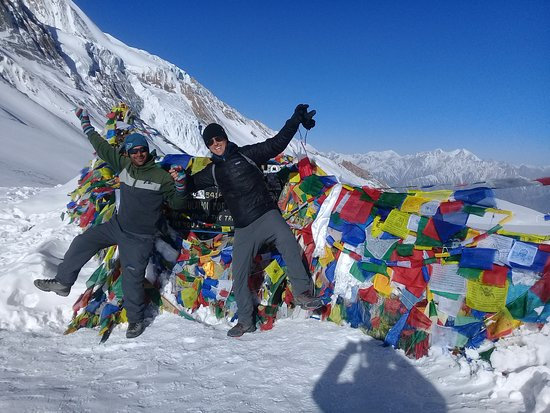Saras Adventure Travel & Tours: Mr Mathias,Chile with our Guide Bishnu  at the summit of Throng Pass(5416m), Annapurna Circuit T
