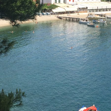 Mouria Fish Tavern Agnontas: Three restaurants Mouria the first on the left blue seating and sun beds available