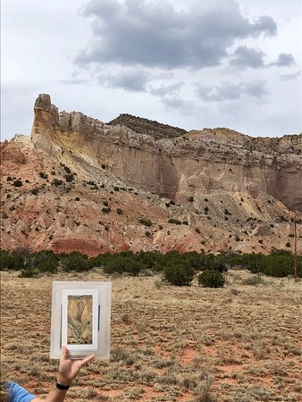 Ghost Ranch - O'Keeffe Landscape Tour: Tour guide shows painting and matches it to landscape area