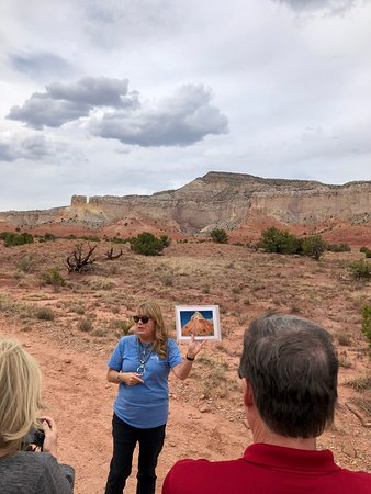Ghost Ranch - O'Keeffe Landscape Tour: tour guide shows O'Keeffe art work and landscape in the background